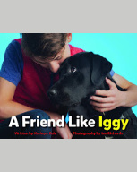 "Cover of ""A Friend Like Iggy"" with a boy hugging a black lab"