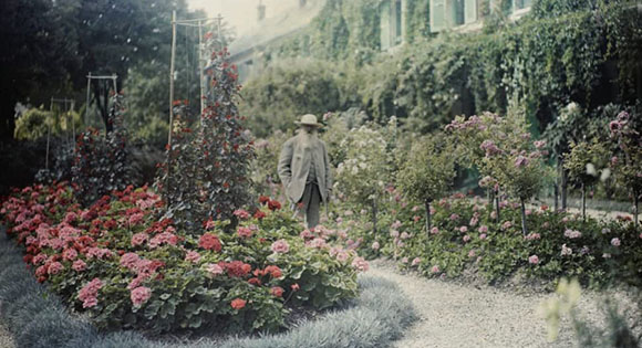 Claude Monet in front of his home in Giverny