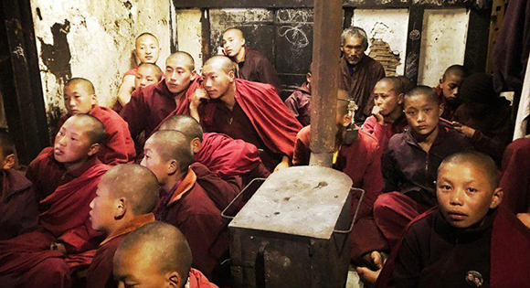 Young monks in Laya watching television.