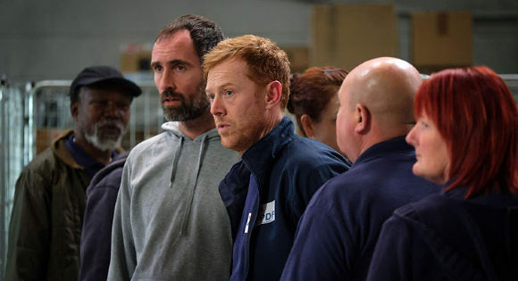 Kris Hitchen as Ricky with other workers looking distressed in Sorry We Missed You.