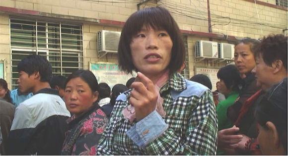 Liu Ximei in a street with other people in Ximei