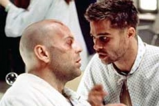 Bruce Willis as Cole and Brad Pitt as patient
