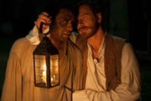 Chiwetel Ejiofor as Solomon and Michael Fassbender as Edwin Epps