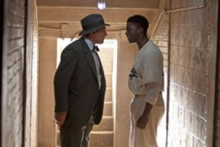 Harrison Ford as Branch and Chadwick Boseman as Jackie