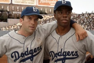 Lucas Black as Pee Wee Reese and Chadwick Boseman as Jackie