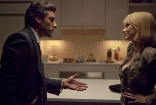 Oscar Isaac as  Abel and Jessica Chastain as Anna