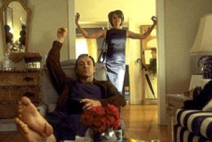 Kevin Spacey as Lester Burnham and Annette Bening as Carolyn Burnham