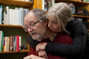 Ruth Sheen as Gerri hugging Jim Broadbent as Tom