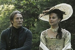 Mads Mikkelsen as Johann Friedrich Struensee and Alicia Vikander as Caroline Mathilde