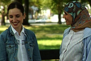 Zoe Lister-Jones as Rochel and Francis Benhamou as Nasira