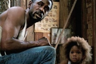 Dwight Henry as Wink and Quvenzhane Wallis as Hushpuppy