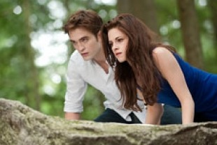 Robert Pattinson as Edward and Kristen Stewart as Bella