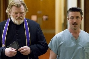 Brendan Gleeson as Father James and Aidan Gillen as Dr. Frank