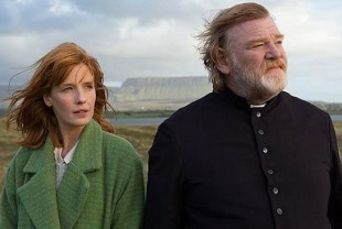 Kelly Reilly as Fiona and Brendan Gleeson as Father James