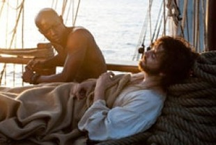David Gyasi as the slave and Jim Sturgess as Adam