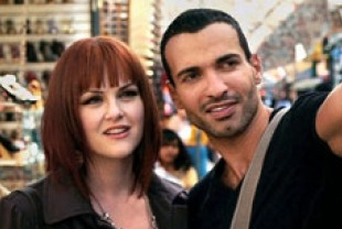 Sara Rue as Deb and Haaz Sleiman as Cookie