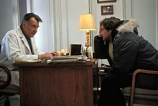 Jim Carrey and Tom Wilkinson as Dr. Howard Mierzwiak