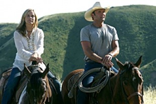 Maria Bello as Nell and Tim McGraw as Rob
