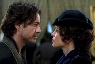Robert Downey Jr. as Holmes and Rachel Adams as Irene