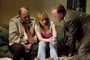 Amy Ryan as Helene (center) and Ed Harris as Remy Bressant
