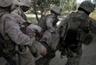 Marines of Echo Company 2nd Battalion, 8th Marine Regiment carry an injured soldier