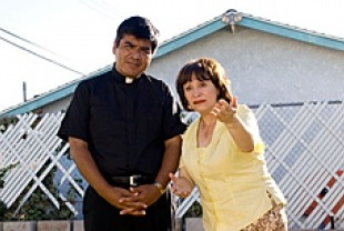 George Lopez as Father Salazar and Adriana Barraza as Esperanza
