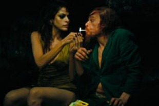 Eva Mendes as the model  Kay M. and Denis Lavant as Oscar