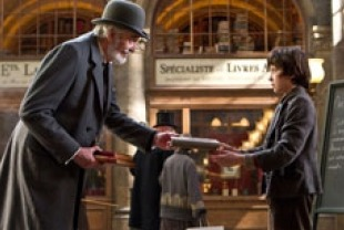 Christopher Lee as the bookseller and Asa Butterfield as Hugo