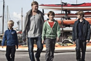 Mikael Persbrandt as  Anton with his two sons and their friend