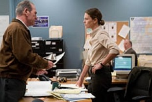 Tommy Lee Jones as Hank and Charlize Theron as Emily Sanders