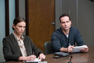 Charlize Theron as Sanders and Jason Patric as Lt. Kirklander