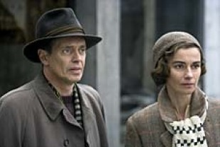 Steve Buscemi as Dr. Robert Wilson and Anne Consigny as Valerie Dupres