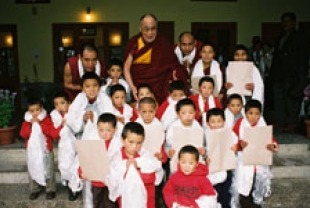 The Dalai Lama with children at monastery