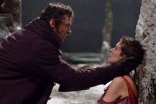 Hugh Jackman as Valjean and Anne Hathaway as Fantine