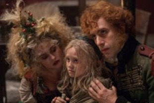 Helena Bonham Carter as Madame Thenardier, Isabelle Allen as young Cosette and Sacha Baron Cohen as Thenardier