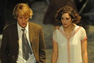 Owen Wilson as Gil and Marion Cotillard as Adrianna