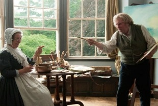 Marion Bailey as Mrs. Booth and Timothy Spall as Mr. Turner