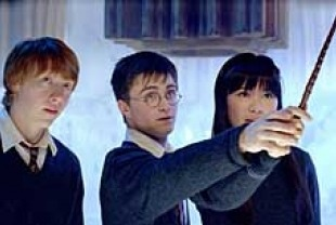 Rupert Grint as Ron, Daniel Radcliffe as Harry, and Katie Leung as Cho Chang