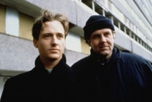 Linus Roache as Father Greg and Tom Wilkinson as Father Matthew