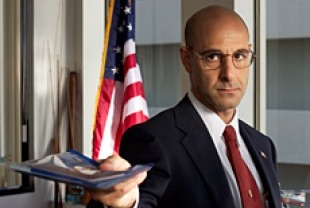 Stanley Tucci as Dixon