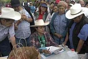 Rufina Juarez (center), the leader of South Central Farmers Feeding Families